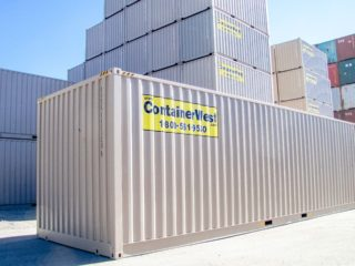 Extra tall container in yard.