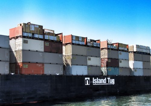 Cargo barge loaded with ContainerWest Containers