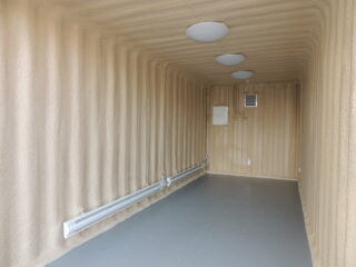 Spray foam on ceiling, walls and undercarriage on a container